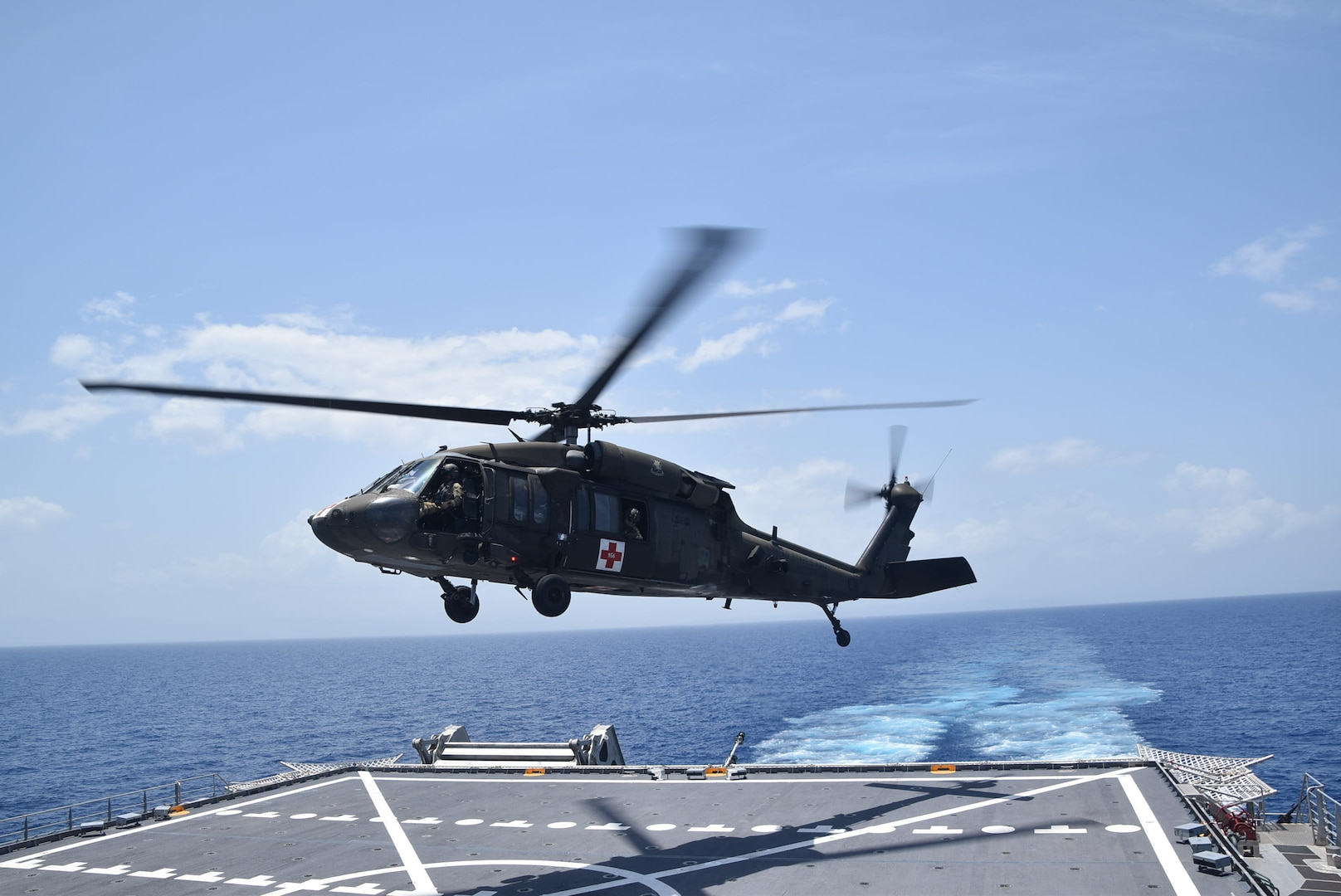 A U.S. Army UH-60 Blackhawk helicopter takes off from the Spearhead-class expeditionary fast transport ship USNS Burlington (T-EPF 10) after refueling, Aug. 21, 2021.