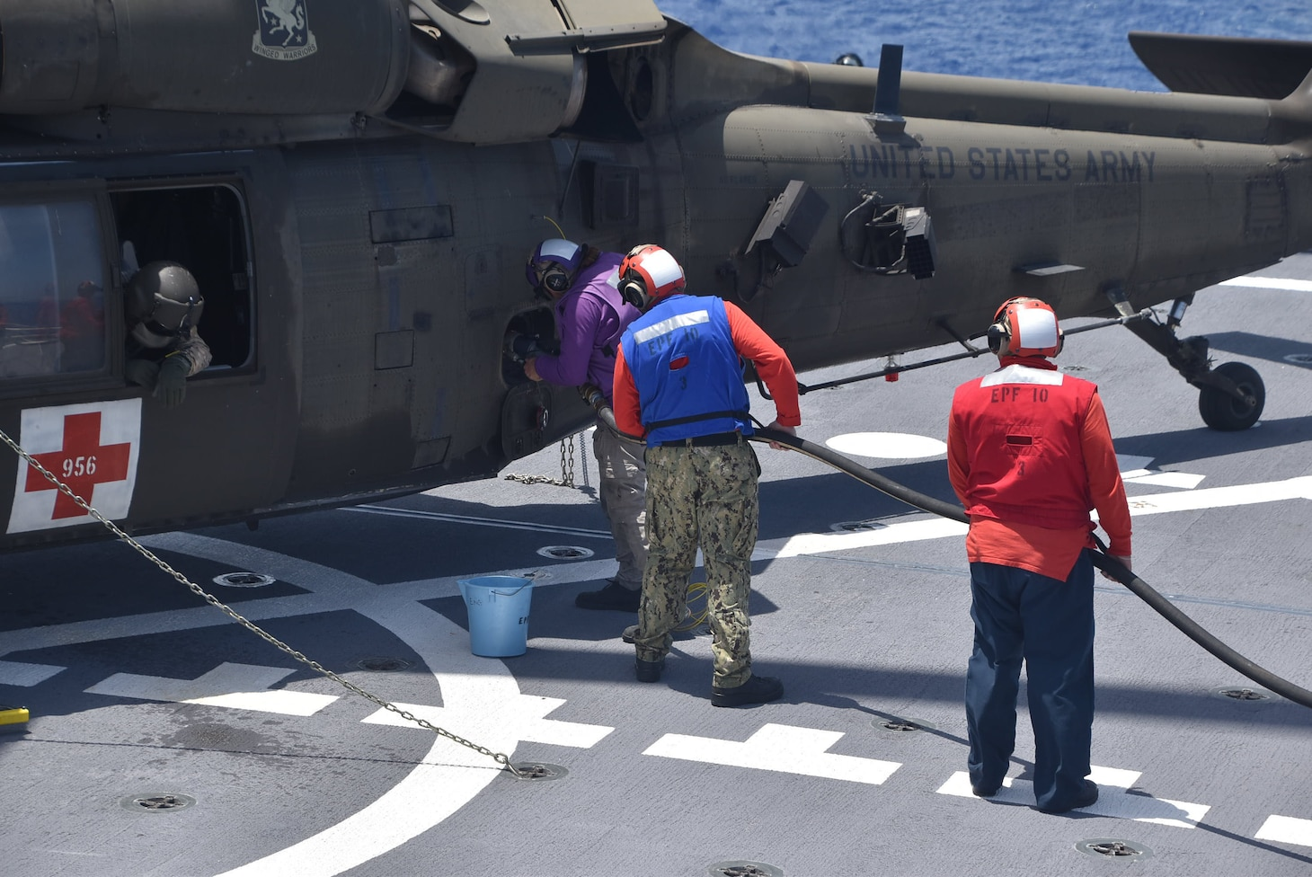 Sailors assigned to the Spearhead-class expeditionary fast transport ship USNS Burlington (T-EPF 10) refuel a U.S. Army UH-60 Blackhawk helicopter on the flight deck, Aug. 21, 2021.