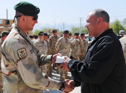 Zoran Konjanovski, the Macedonian minister of defense, shakes the hand of a soldier serving in the Macedonian Embedded Task Force and presents him with a medal during a ceremony welcoming the task force to Afghanistan, April 5. The Macedonian soldiers on the embedded training team will serve with the 86th Infantry Brigade Combat Team, based out of Vermont. Macedonia and Vermont have had a partnership program since 1993, but this is the first time that they have served together in a combat zone.