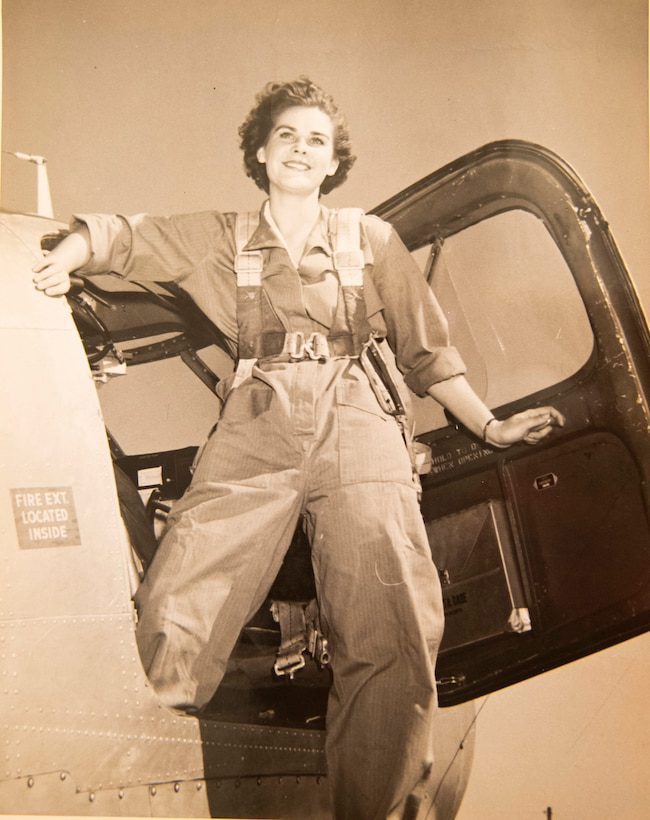 A photo of Lorraine Vogelsang, a Women's Army Corps veteran, climbing out of an aircraft during her time in the service sits on display at her Cincinnati, Ohio, home, Aug. 19, 2021. Vogelsang served in the WAC from February 1943 until August 1945. (U.S. Air Force photo by Wesley Farnsworth)