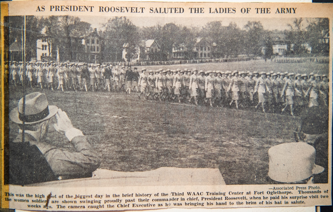 A news clipping of Lorraine Vogelsang, a Women's Army Corps veteran, and other WAC members parading for then President Roosevelt, sits inside a scrapbook at her Cincinnati, Ohio, home, Aug. 19, 2021. Vogelsang served in the WAC from February 1943 until August 1945. (U.S. Air Force photo by Wesley Farnsworth)