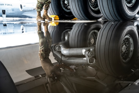 Senior Airman Clayton Roppa, 911th Aircraft Maintenance Squadron crew chief, wipes down the landing gear of a C-17 Globemaster III at the Pittsburgh International Airport Air Reserve Station, Pennsylvania, Aug. 16, 2021. Airmen routinely wipe down a variety of parts of the aircraft to help prevent corrosion.