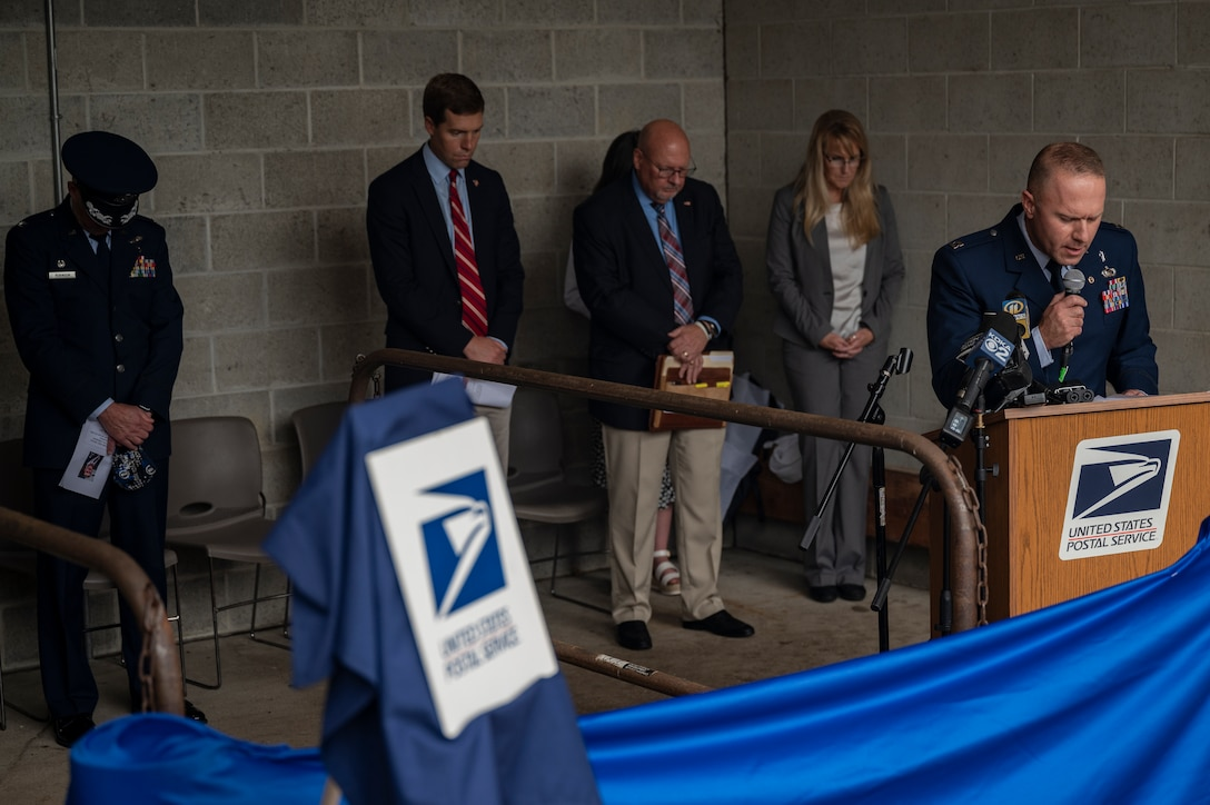 Capt. Jeremy Caskey, 911th Airlift Wing chaplain, delivers the invocation during a dedication ceremony renaming the post office in Hookstown, Pennsylvania, Aug. 16, 2021. The post office was renamed after a fallen Airman, Staff Sgt. Dylan Elchin, who was killed by a roadside bomb in Afghanistan's Ghazni province in November 2018.