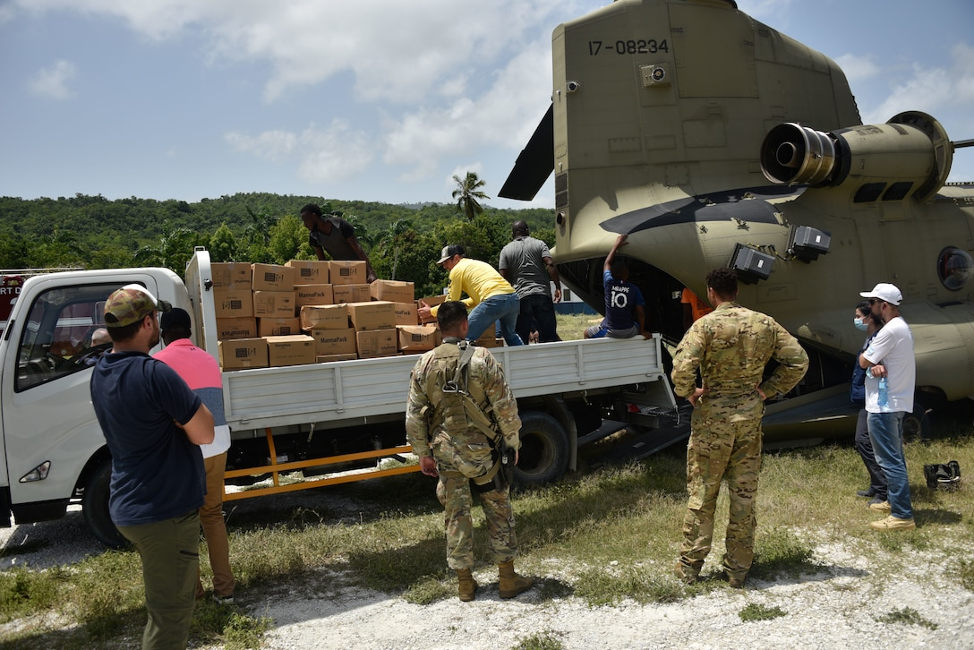 A U.S. Army CH-47 Chinook Helicopter crew and partner agencies deliver emergency medical equipment and food to Haitian citizens in impacted areas of Haiti, Aug. 23, 2021.