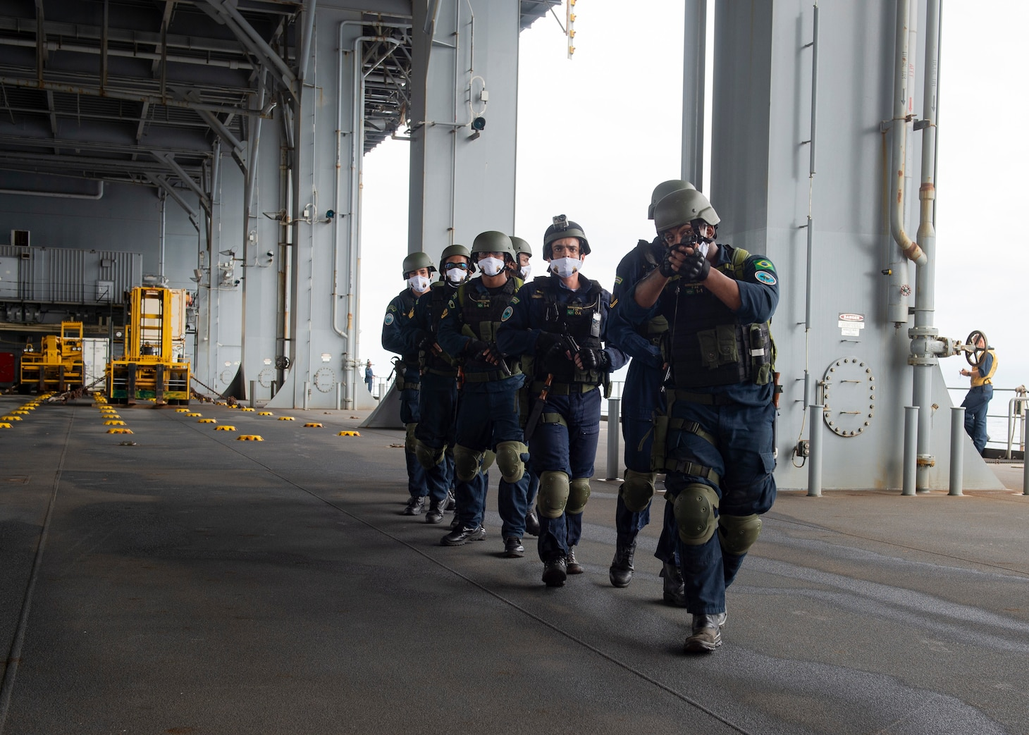 """Brazilian Navy Sailors perform a visit, board, search, and seizure drill aboard the Expeditionary Sea Base USS Hershel """"Woody"""" Williams (ESB 4), Aug. 22, 2021. Hershel """"Woody"""" Williams is conducting a maritime security capability exercise to build on its existing partnership with the Brazilian Navy and joint interoperability operations with allies and partners during a scheduled deployment in the U.S. Sixth Fleet area of operations in support of U.S. national interests and security in Europe and Africa."""
