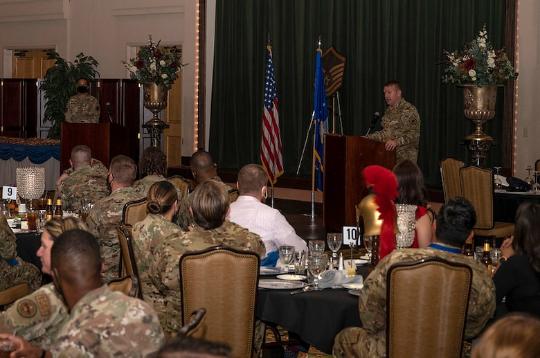 Chief speaks to attendees at banquet.