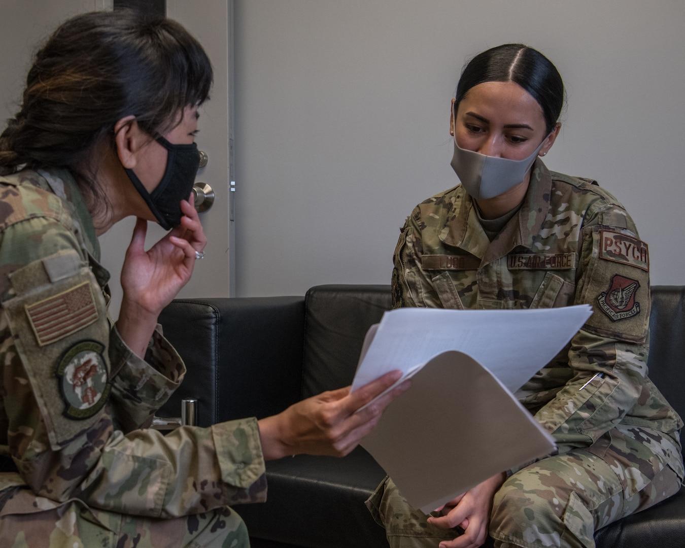 Two service members talking