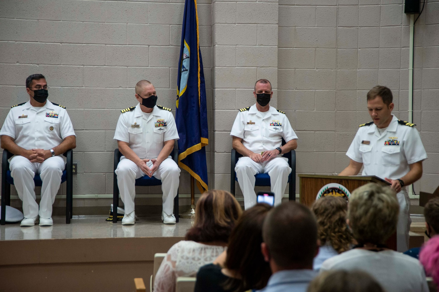 Lt. Cmdr. Nicholas Tuuk, right, executive officer of Pre-commissioning unit New Jersey (SSN 796) introduces the official party during a change-of-command ceremony at Submarine Learning Facility Norfolk in Norfolk, Va., Aug. 20, 2021.