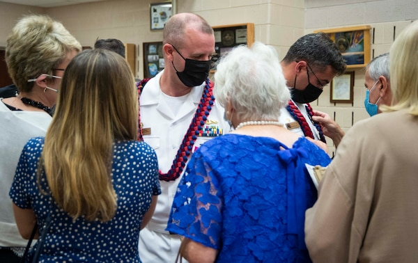 Cmdr. Joseph Spinks, left, and Cmdr. Carlos Otero, commanding officer of Pre-commissioning unit New Jersey (SSN 796) greet friends and family after a change-of-command ceremony held at Submarine Learning Facility Norfolk in Norfolk, Va., Aug. 20, 2021.
