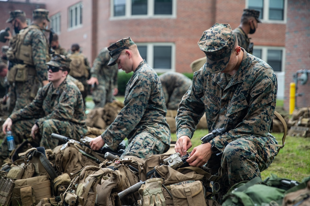 U.S. Marine Corps 2nd Lt. Cody Snyder, left, an infantry officer from Raleigh, N.C., and 2nd Lt. Michael Andre, an infantry officer from Naperville, Fla., both with 3rd Battalion, 6th Marine Regiment, 2d Marine Division, go over gear counts during a deployment preparation drill at Camp Lejeune, N.C., Aug. 20, 2021.
