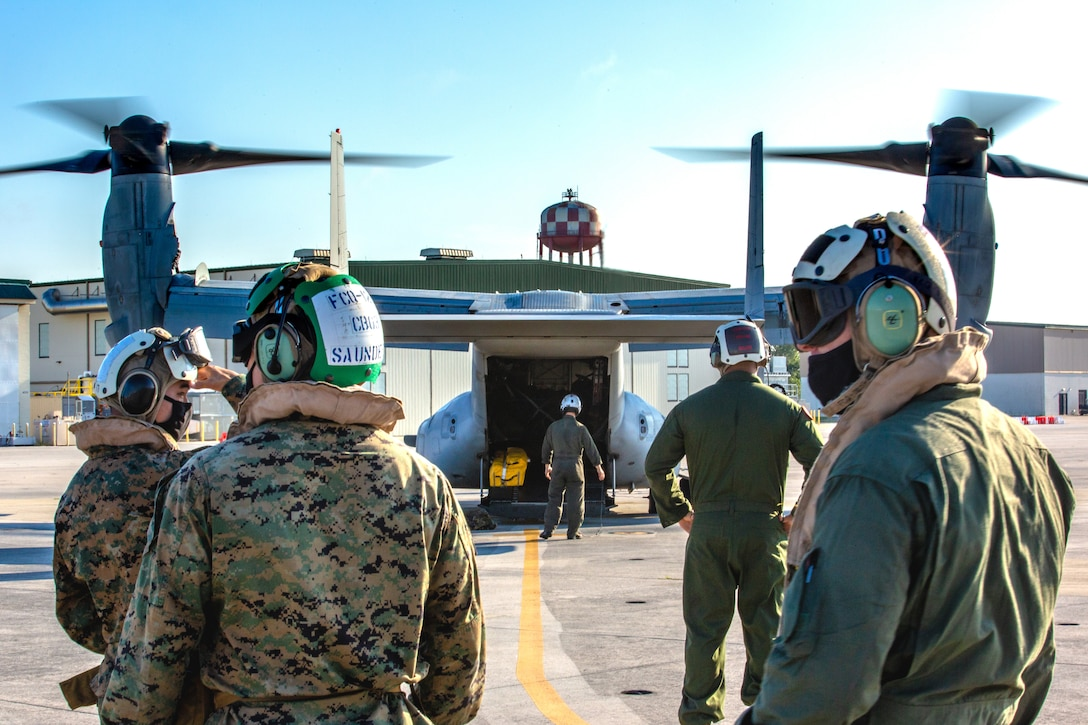 United States Marines with 2nd Marine Aircraft Wing, II Marine Expeditionary Force, prepare to board MV-22B Ospreys to deploy to Haiti in support of Joint Task Force-Haiti for a humanitarian-assistance and disaster-relief mission from Marine Corps Air Station New River, North Carolina, Aug. 23, 2021. (U.S. Marine Corps photo by Lance Cpl. Eric Ramirez)