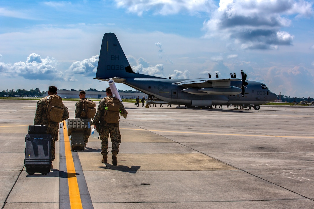 United States Marines with 2nd Marine Aircraft Wing, II Marine Expeditionary Force, prepare to deploy to Haiti in support of Joint Task Force-Haiti for a humanitarian-assistance and disaster-relief mission from Marine Corps Air Station New River, North Carolina, Aug. 23, 2021. (U.S. Marine Corps photo by Lance Cpl. Eric Ramirez)