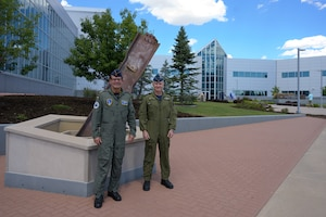 German Air Force Major-General Karsten Stoye, NATO's Chief of Staff Allied Air Command, stands with Royal Canadian Air Force Major-General Patrick Carpentier, North American Aerospace Defense Command Director of Operations, at the command's 9/11 Memorial during his visit to the NORAD and U.S. Northern Command Headquarters at Peterson Space Force Base, Colorado, Aug. 23, 2021. Stoye traveled to the headquarters to receive information on the Global Information Dominance Experiments and discuss with leadership how NORAD and USNORTHCOM and NATO can collaborate on missile defense.