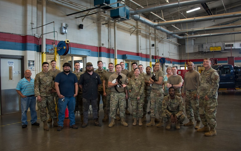 Members of the 97th Logistics Readiness Squadron pose for a picture with baby goats Ozzy and Cher at Altus Air Force Base, Oklahoma, June 15, 2021. U.S. Air Force Master Sgt. Thomas Kessler, 97th Logistics Readiness Squadron Vehicle Management Flight superintendent, brought the goats from his ranch to visit Airmen and boost morale within the squadron. (U.S. Air Force photo by Senior Airman Amanda Lovelace)