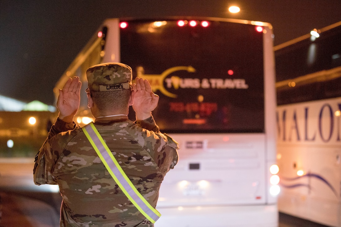 U.S. Army Pvt. Tyson Gaulden, assigned to 804th Transportation Detachment, 382nd Combat Sustainment Support Battalion, helps safely stage buses in support of Operation Allies Refuge, July 29, 2021 at the Dulles International Airport in Virginia.