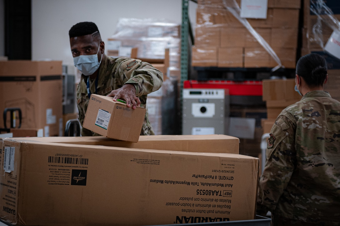 Task Force McGuire-Dix Airmen prepare personal protective equipment to aid in the arrival of Afghans  in support of the Department of State-led Operation Allies Refuge on Joint Base McGuire-Dix-Lakehurst, New Jersey, Aug. 21, 2021.