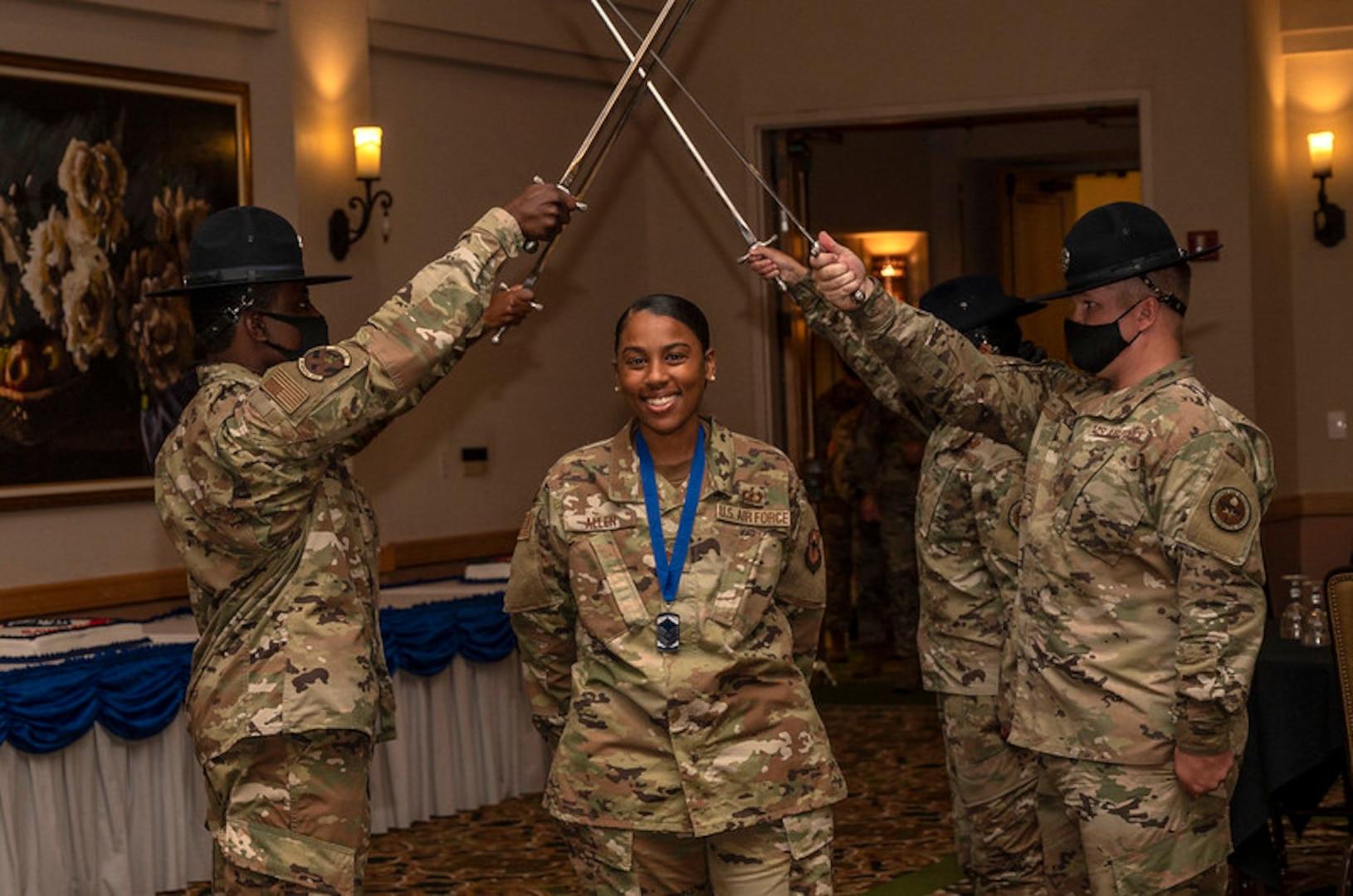 Female NCO passes under saber cordon