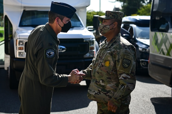 Commanders greet each other during a visit.