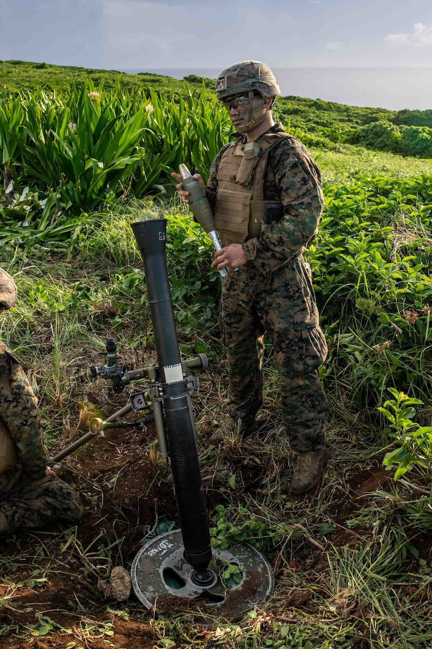 Lance Cpl. Josiah Rodriguez, from Los Angeles, assigned to the 31st Marine Expeditionary Unit (MEU), forward-deployed on the amphibious assault ship USS America (LHA 6), prepares to fire an 81 MM mortar during a fire support coordination exercise. America, flagship of the America Expeditionary Strike Group, along with the 31st MEU, is operating in the U.S. 7th Fleet area of responsibility to enhance interoperability with allies and partners and serve as a ready response force to defend peace and stability in the Indo-Pacific region.