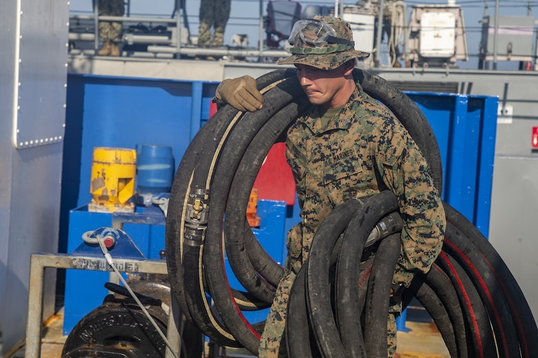 U.S. Marine Sgt. Nicholas D. Niner caries tubes during Large Scale Exercise 2021 at Camp Lejeune, North Carolina, Aug. 8, 2021. LSE 2021 demonstrates the Navy's ability to employ precise, lethal, and overwhelming force globally across three naval component commands, five numbered fleets, and 17 time zones. LSE 2021 merges live and synthetic training capabilities to create an intense, robust training environment. It will connect high-fidelity training and real-world operations, to build knowledge and skills needed in today's complex, multi-domain, and contested environment.