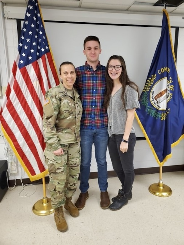 Staff Sgt. Lori Lawson poses for a photo at the Louisville MEPS station with enlistee Jacob Kinman. (Courtesy photo)