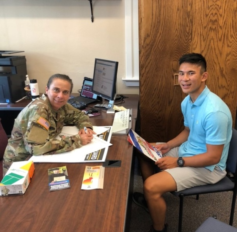 Staff Sgt. Lori Lawson talks to Stephen Burger, a student at Eastern Kentucky University about joining the Guard. . (Courtesy photo)