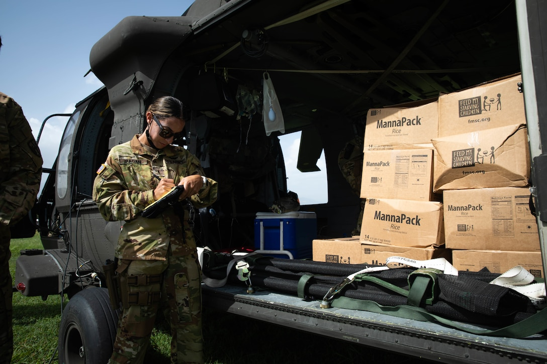 Warrant Officer (WO1) Adaliz Pagan performs an inventory check before transporting food provisions to the community of Jeremie, Haiti, Aug. 24, 2021.