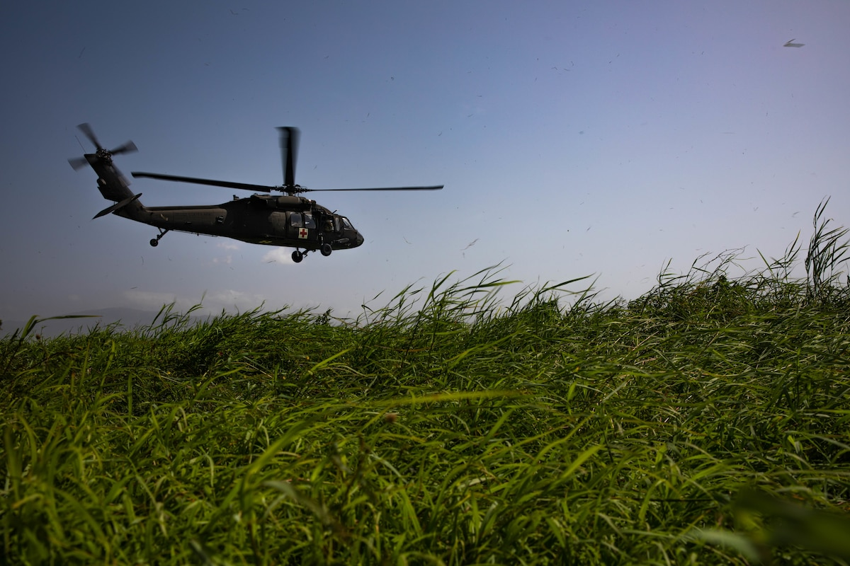 A UH-60 helicopter from the Puerto Rico Army National Guard Aviation departs Port-au-Prince Airport, Haiti, Aug. 24, 2021.