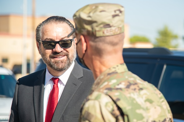 Brig. Gen. Gregory Kreuder, right, 56th Fighter Wing commander, greets Mark Brnovich, left, Arizona Attorney General, Aug. 20, 2021, at Luke Air Force Base, Arizona. Brnovich's visit included a wing mission brief, an Academic Training Center tour and an F-35A Lightning II virtual demonstration conducted by pilots with the 62nd Fighter Squadron. Brnovich toured the base and met with wing leadership to observe Luke's mission of training the world's greatest fighter pilots and combat-ready Airmen. (U.S. Air Force photo by Staff Sgt. Collette Brooks)