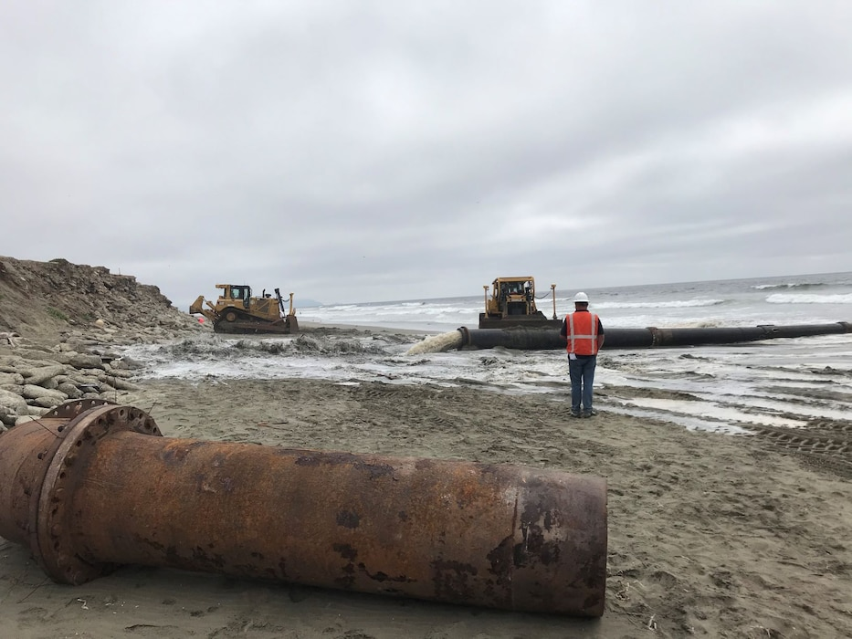 Sand, beach, ocean and construction equipment