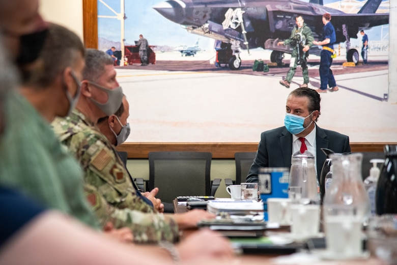 Mark Brnovich, right, Arizona Attorney General, engages with 56th Fighter Wing leadership during a wing mission brief Aug. 20, 2021, at Luke Air Force Base, Arizona. During the brief, leadership discussed various topics such as Luke AFB history, family support agencies and the overall base mission. Brnovich toured the base and met with wing leadership to observe Luke's mission of training the world's greatest fighter pilots and combat-ready Airmen. (U.S. Air Force photo by Staff Sgt. Collette Brooks)