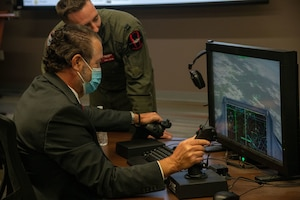Mark Brnovich, Arizona Attorney General, uses a hands-on throttle and stick component Aug. 20, 2021, at Luke Air Force Base, Arizona. Brnovich increased his understanding of the F-35A Lightning II capabilities through virtual flight training, which features the aircrafts digital display and controls. Brnovich toured the base and met with wing leadership to observe Luke's mission of training the world's greatest fighter pilots and combat-ready Airmen. (U.S. Air Force photo by Staff Sgt. Collette Brooks)