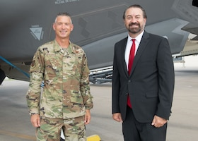 Mark Brnovich, right, Arizona Attorney General, and Brig. Gen. Gregory Kreuder, left, 56th Fighter Wing commander, pose for a photo in front of an F-35A Lightning II during a base visit Aug. 20, 2021, at Luke Air Force Base. Brnovich toured various places around base to include the 56th FW Headquarters, F-35 Academic Training Center, and the 62nd Fighter Squadron. Brnovich toured base and met with wing leadership to observe Luke's mission of training the world's greatest fighter pilots and combat-ready Airmen. (U.S. Air Force photo by Staff Sgt. Collette Brooks)