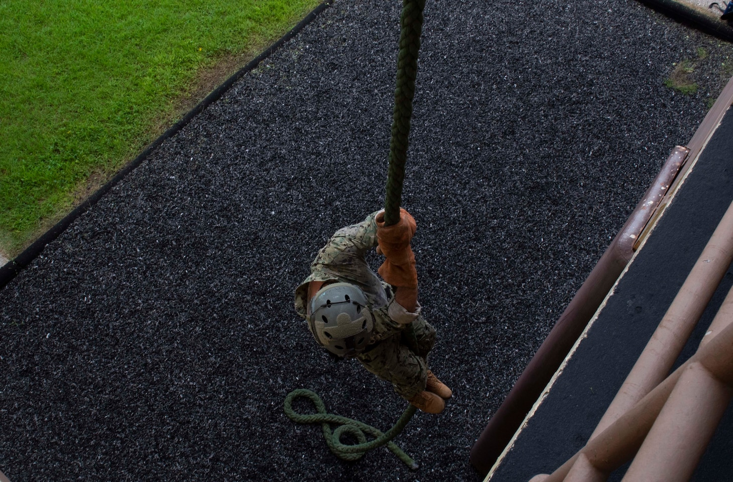 A U.S. Naval Special Warfare operator practices fast-rope techniques with partner nations as part of MALABAR 2021. MALABAR 2021 is an example of the enduring partnership between Australian, Indian, Japanese and American maritime forces, who routinely operate together in the Indo-Pacific, fostering a cooperative approach toward regional security and stability. Naval Special Warfare is the nation's premiere maritime special operations force and is uniquely positioned to extend the Fleet's reach and deliver all-domain options for naval and joint force commanders.