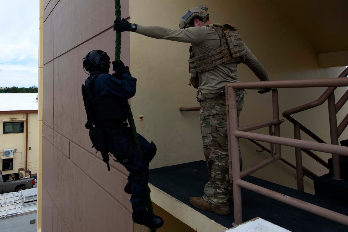 A U.S. Naval Special Warfare operator holds a rope for a Japan Maritime Self-Defense Force sailor as part of MALABAR 2021. MALABAR 2021 is an example of the enduring partnership between Australian, Indian, Japanese and American maritime forces, who routinely operate together in the Indo-Pacific, fostering a cooperative approach toward regional security and stability. Naval Special Warfare is the nation's premiere maritime special operations force and is uniquely positioned to extend the Fleet's reach and deliver all-domain options for naval and joint force commanders.