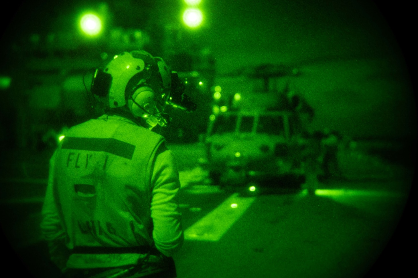 Aviation Boatswain's Mate (Handling) Airman Jesse Click, from Sylvan Springs, Ala., assigned to the forward-deployed amphibious assault ship USS America (LHA 6), signals an MH-60S Seahawk helicopter from the Helicopter Sea Combat Squadron (HSC) 25. America, flagship of the America Expeditionary Strike Group, along with the 31st Marine Expeditionary Unit, is operating in the U.S. 7th Fleet area of responsibility to enhance interoperability with allies and partners and serve as a ready response force to defend peace and stability in the Indo-Pacific region.