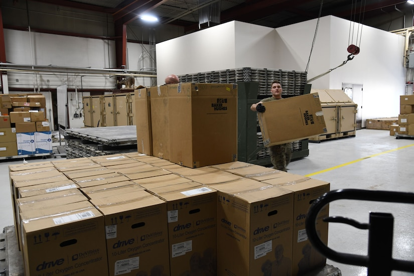 Airmen from the 151st Logistics Readiness Squadron palletize medical equipment and supplies Aug 25, 2021, at Roland Wright Airbase in Salt Lake City, Utah
