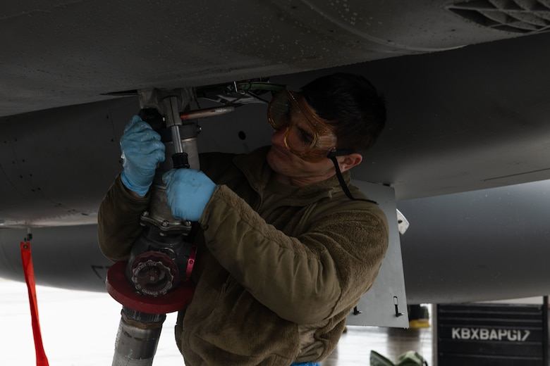 U.S. Air Force Senior Airman Cody Greco, an 18th Aircraft Maintenance Squadron dedicated crew chief from Kadena Air Base, Japan, attaches an aircraft refueling hose to an F-15C Eagle during RED FLAG-Alaska 21-3 at Eielson Air Force Base, Alaska, Aug. 23, 2021. The 354th Logistics Readiness Squadron petroleum, oil, and lubricants flight can fuel over 100 aircraft a day. (U.S. Air Force photo by Senior Airman Rhonda Smith)