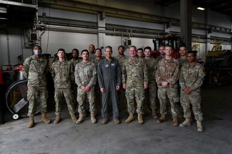Service members pose for a group photo.