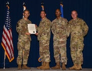 People in uniform receive an award