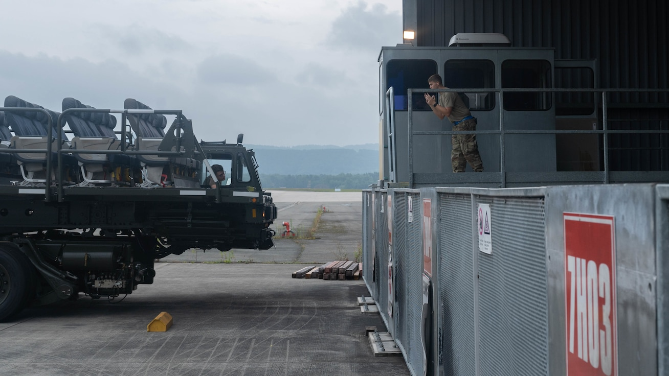 Airman directs cargo vehicle.