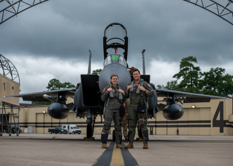 Capt. Lauren Schlichting, left, 333rd Fighter Squadron evaluating pilot and executive officer, and Capt. Andrew Lombardo, 333rd FS weapons system officer, pose for a photo at Seymour Johnson Air Force Base, North Carolina, August 4, 2021.