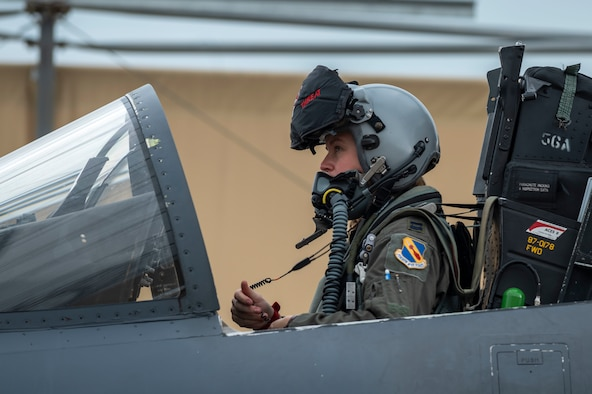 Capt. Lauren Schlichting, 333rd Fighter Squadron evaluating pilot and executive officer, performs and instrument check on an F-15E Strike Eagle at Seymour Johnson Air Force Base, North Carolina, August 4, 2021.