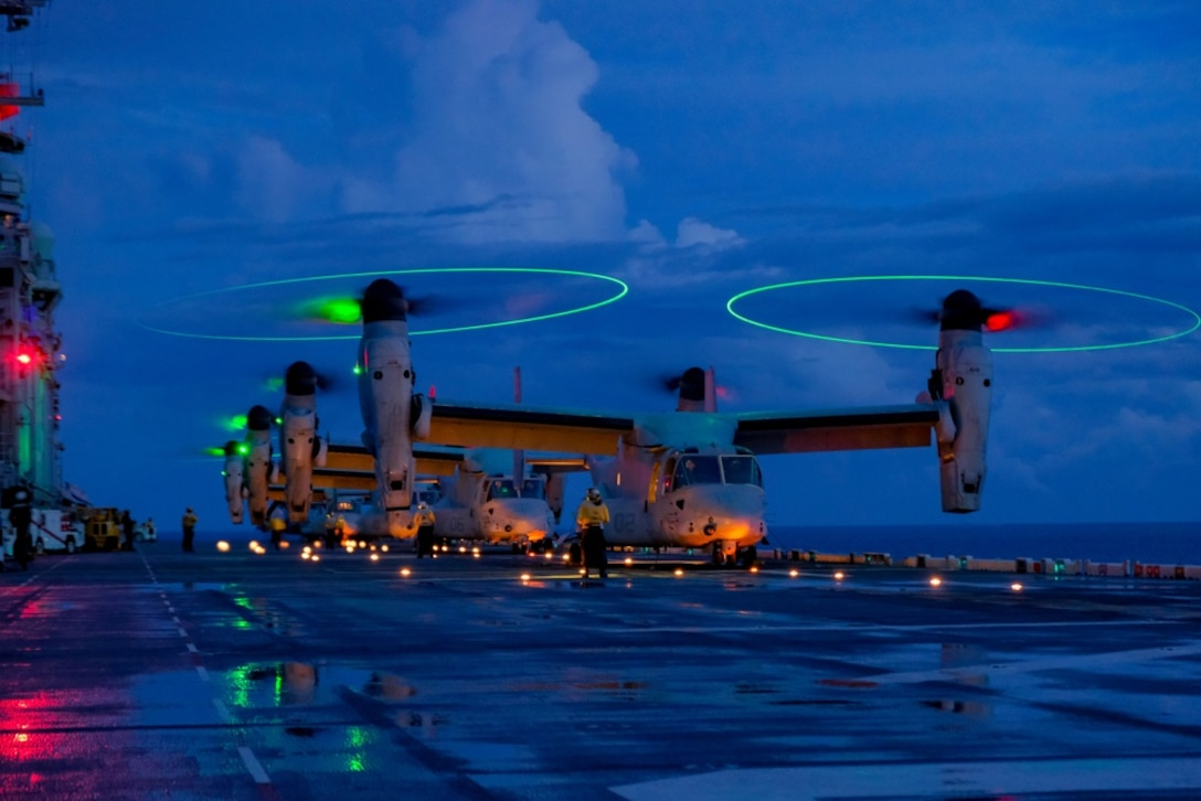U.S. Marine Corps MV-22B's with Marine Medium Tiltrotor Squadron 265 (Reinforced), 31st Marine Expeditionary Unit, prepare for take-off aboard the amphibious assault ship USS America, in the Philippine Sea Aug. 17, 2021. The MV-22B provides combatant commanders with extended range and flexibility for a wide range of missions. The 31st MEU is operating aboard ships of America Expeditionary Strike Group in the 7th fleet area of operations to enhance interoperability with allies and partners and serve as a ready response force to defend peace and stability in the Indo-Pacific region.