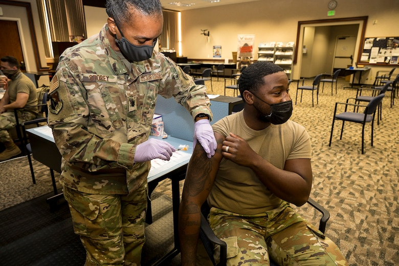 Senior Airman Rendall Powell, 412th Test Wing, receives a COVID-19 vaccination shot from Lt. Col. Yvonne Storey, 412th Medical Group, at the Airman and Family Readiness Center on Edwards Air Force Base, California, Aug. 25. Secretary of Defense Lloyd J. Austin III issued a memorandum directing mandatory COVID-19 vaccinations for service members. John F. Kirby, Pentagon press secretary, said only Food and Drug Administration-approved vaccines will be mandatory. (Air Force photo by Katherine Franco)