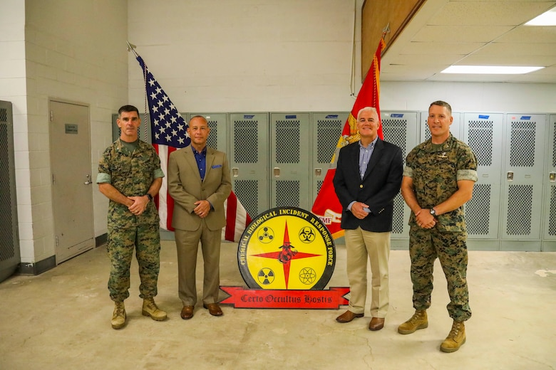 Indian Head, Maryland (July 30, 2021) – The Current and former Commanding officers of the Chemical Biological Incident Response Force (CBIRF), pose for a photo after the CBIRF change of command ceremony at Naval Support Facility Indian Head, Md. The ceremony signifies the transfer of command authority and responsibility from Riley to Col. Dean A. Schulz. (U.S. Marine Corps photo by SSgt Kristian S. Karsten/Released)