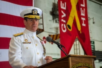Rear Adm. Ryan Scholl, commander, Carrier Strike Group (CSG) 8, delivers remarks during a change of command ceremony for CSG-8 in the hangar bay of the Nimitz-class aircraft carrier USS Harry S. Truman (CVN 75).