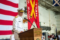 Rear Adm. Curt Renshaw, commander, Carrier Strike Group (CSG) 8 delivers remarks during a change of command ceremony for CSG-8 in the hangar bay of the Nimitz-class aircraft carrier USS Harry S. Truman (CVN 75).