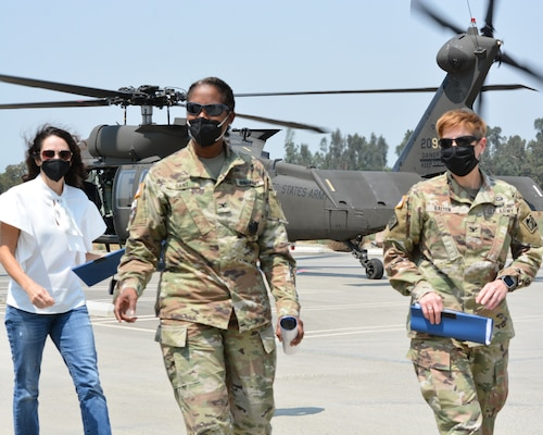 """Col. Antoinette """"Toni"""" Gant, commander of the Corps' South Pacific Division, center; Cheree Peterson, SES, programs director, South Pacific Division, left; and Col. Julie Balten, LA District commander, right, arrive at Prado Dam Resident Office Aug. 24 in Corona, California."""