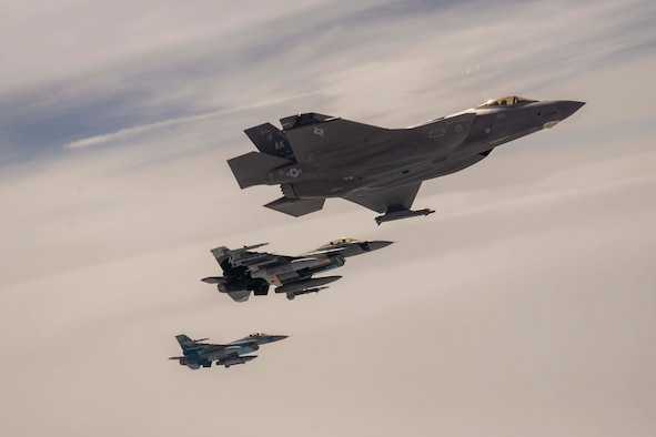 An F-35A Lightning II and two F-15 Fighting Falcons, assigned to the 354th Fighter Wing from Eielson Air Force Base, Alaska, flies above the Joint Pacific Alaska Range Complex, July 28, 2021. The F-35As participated in air refueling with the Alaska Air National Guard's 168th Wing's KC-135R Stratotanker. (U.S. Air Force photo by Staff Sgt. Kaylee Dubois)